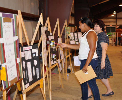 Two women judging displays in home arts barn